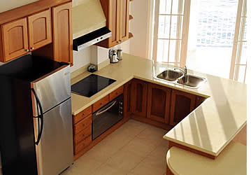 The kitchens within each room at Tropical Suites is fully equipped